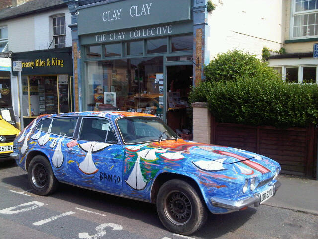 Bango painted Reliant Scimitar GTE in front of ClayClay, 15 High St, Bembridge, Isle of Wight PO35 5SD